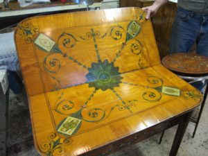 The table needs a lot of veneer repair to new damage and old repairs that were done incorrectly.