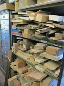 Many varieties of wood are kept on hand to match up for repair purposes.