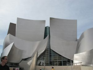 Sheathed in stainless steel, the hall covers more than four acres and houses four performance arenas.