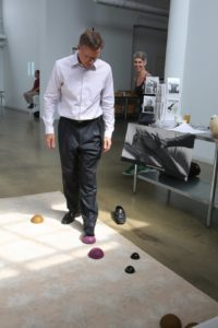EVP, General Counsel Peter Hurwitz trys out basic foot exercises utilizing the Yamuna method.