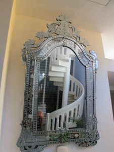 I loved this mirror - the spiral stair case is part of the Baba House extension.