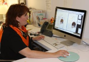 Ruth meticulously editing a story for the Dubai Weddings edition