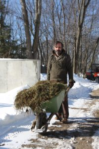 Ron Brooks, the livestock manager, was mucking out the barn and brought a load to add to the piles.