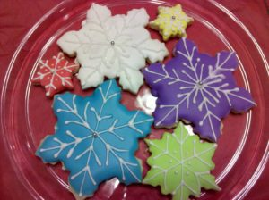 These are lemon-vanilla bean snowflake sugar cookies decorated with royal icing. Carrie Metz from Waldorf, MD baked 76 of these and gave them as teacher gifts.