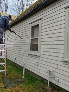 Next, Carlos moves on to my gym building. Another tip is to always move the pressure washer's wand in an even, up-and-down motion. This will clean the surface without damaging the siding. And never let the spray linger in any one place.