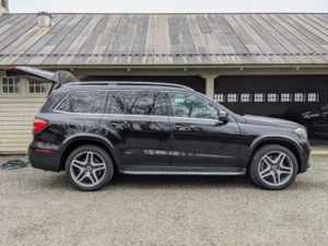 This is my Mercedes-Benz GLS550. It's such a great car. My drivers and I love its maneuverability and comfort. On this day, while I am inside organizing the pantry, my driver, Andres, is outside washing the cars.