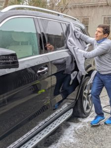 Andres uses several soft towels to dry the vehicle. He wipes down every surface carefully. He goes over the car multiple times to make sure there is no standing water anywhere on the car which can tarnish the paint or cause rust.
