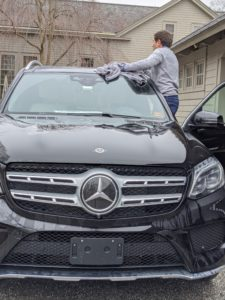 Andres also dries the top of the vehicle and is careful around the sliding and tilting glass sunroof.