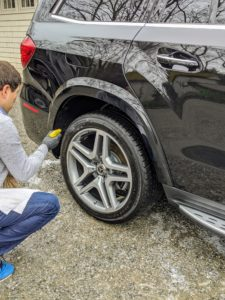 Last step - Andres sprays the wheels so they shine.