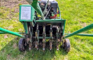 This aerator has 30 steel tines, which remove small cores of soil from the lawn.