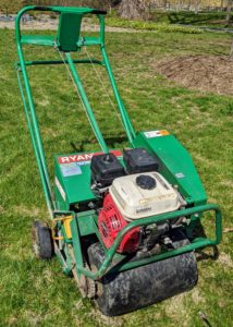 This is our Ryan Lawnaire IV walk-behind aerator. Because my lawns are quite large, it is much easier to use a machine specifically designed for this process.