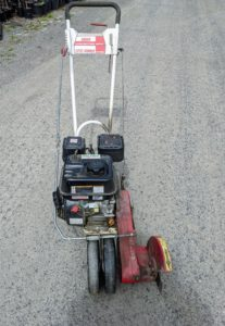 This is such a handy tool – it is my Little Wonder gas-powered edger – a single purpose machine used to make good, crisp lines along the edges of garden beds and lawns.