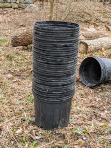As the trees are planted, all the pots are stacked and saved. We save pots whenever we can – they always come in handy for projects like these, and I always encourage the crew to reuse supplies whenever possible.