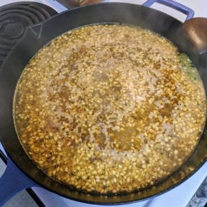 After the chicken is cooked and removed from the skillet, Cheryl cooks the Italian 5-Grain blend, broth mixture, and any reserved marinade, scraping up any browned bits from the bottom of the pan.