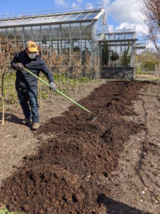 Phurba spreads a generous two to three-inch layer over the existing soil. Compost helps make the soil more absorbent and is a great way to add nutrients back into the earth. It is also a good way to ensure big, bountiful crops.