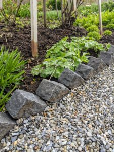 It is at the perfect height against the bricks. This native washed stone is grey blended gravel with a mix of white and brown.