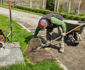 Pete carefully pulls up the sod and removes some of the soil underneath.