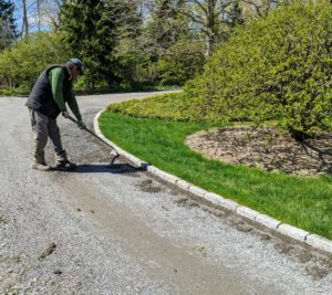 Pete also uses the hoe to clean any growth from this section of the road that is lined with brick pavers.