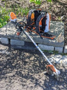 An edger is a very handy tool. This is our new STIHL Kombi System with Lawn Edger attachment. The attachment is a single purpose tool that is used to make good, crisp lines along the edges of garden beds and lawns.
