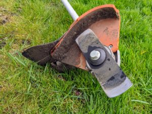 The blade is about five inches long, which cuts a very clean edge. Here it is protected by a cutter head that can also prevent some of the debris from flying. The lawn edger blade is made of carbon steel that is tempered and blackened to resist corrosion.