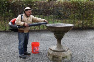 To remove all water from this heavy, antique birdbath, Gyurme blew it dry.