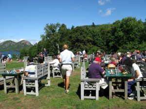 The outdoor seating area offers spectacular views of the pond.