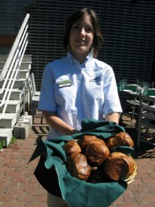 Waitress Emily presents a scrumptious basket of fresh and steamy popovers.