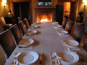The table was set in the dining room with a fire blazing.