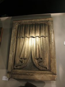 A carved wooden curtain