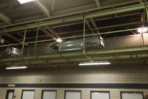 The unfinished cars travel high up on a conveyor getting them from one station to another.
