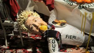  Guy Fieri squirting mustard at the glass