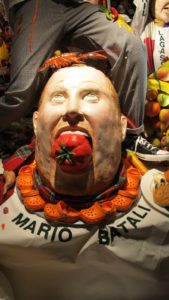 Poor Mario Batali - his head has been decapitated and place on a platter surrounded by tiny orange crocs, his shoe of choice.  Slightly macabre.