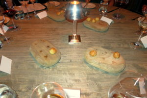 Welcome to dinner at Bacchanalia with the American Cancer Society.  The cheese puffs were so good and were served on rustic wooden boards.