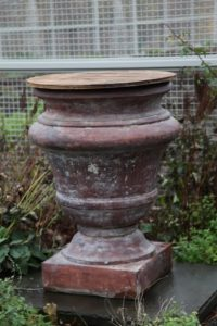 I purchased these two magnificent Kenneth Lynch and Sons pots at an auction when Kenneth Lynch was still in operation in Wilton, Connecticut.  The urns are cast concrete, a formula which no one has figured out.  They are magnificent!