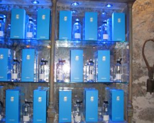 The wall behind the bar in the interior courtyard of Casa Dragones has a lovely display of the sky blue packaging and the handcrafted, pure, lead-free crystal bottles.