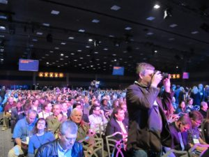 The large audience was seated and waiting for the keynote to begin.