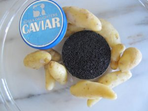 The hors d'œuvre was boiled fingerling potatoes and osetra caviar from Russ & Daughters.  http://www.russanddaughters.com/