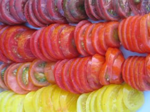 He picked an assortment of heirloom tomatoes and sliced them thinly.  They're so beautiful.