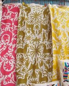 These fabrics are typical Mexican applique work.