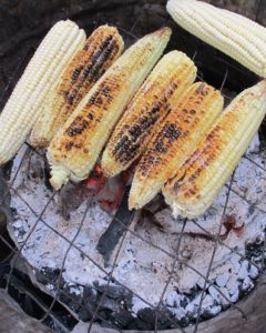 The smell of corn roasting over wood coals was wafting in the air.