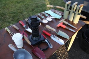 Some very basic gardening tools and some very sophisticated photography equipment