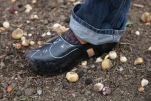 Frans was wearing his traditional Dutch wooden shoes.