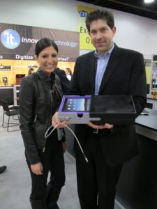 Rachael Hecht and Evan Dash, of Innovative Technologies, displayed a portable safe for iPads and other valuables.