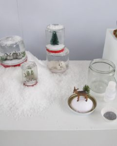 Winter Wonderland from 1998 - These tiny worlds, constructed from repurposed glass jars and dime-store toys, bottle the romance of the first snowfall.