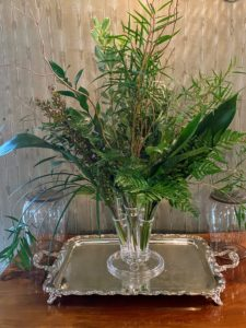 I love greens - a vase of all green foliage looks so elegant on a silver platter like this.