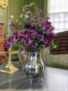 Don't be afraid to experiment. Here, I used a silver pitcher for the vase - look for interesting vessels around your home.