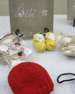 Calia Van Dyke made adorable knitted baby booties and caps.