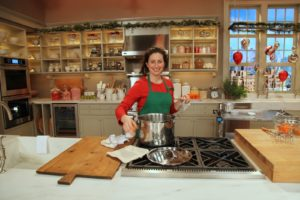 Nora Singley - TV chef - readies the set for a cooking demonstration showing how to make persimmon pudding.