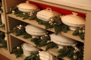 The white-ware collection looks wonderful with evergreens and silver.