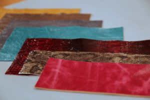 She uses leather in various colors and patterns.